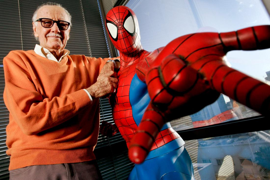 UNITED STATES - DECEMBER 18:  Stan Lee, founder of Marvel Entertainment Inc., poses next to a Spider-Man model in his office in Beverly Hills, California, U.S., in this file photo taken on Dec. 18, 2008. Walt Disney Co. agreed to buy Marvel Entertainment Inc. for about $4 billion in cash and stock in August 2009, adding comic-book characters Iron Man and Spider-Man to Disney's lineup of princesses and live-action stars.  (Photo by Jonathan Alcorn/Bloomberg via Getty Images)