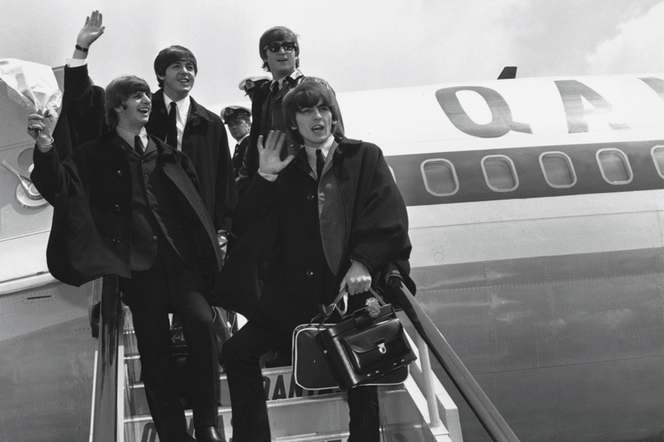 392279 07: (FILE PHOTO) The Beatles (L to R) Ringo Starr, Paul McCartney, John Lennon and George Harrison wave to fans July 2, 1964 as they return to London from a tour of Australia. It was reported November 8, 2001 that Harrison is undergoing cancer treatment in a Staten Island, NY hospital. The 58-year-old ex-Beatle was diagnosed with lung cancer and a brain tumor earlier this year. (Photo by Getty Images)